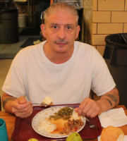 Homless man eating a meal